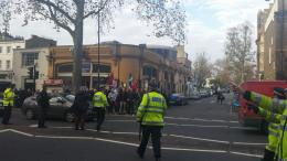 The Pathetic group of fascists gather outside the tube station.