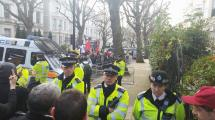 Police guarding the tiny group of fascists