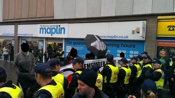 Some of the assembled antifascists give the EDL a hard time.