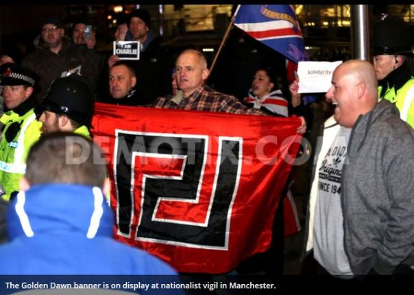 "The Golden Dawn symbol on display at a ""Je Suis Charlie"" rally in Manchester."