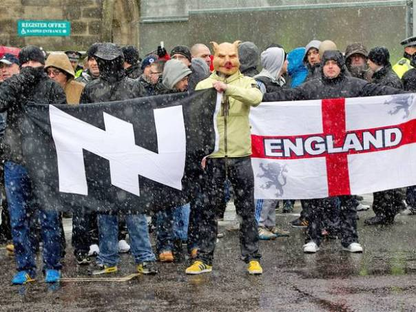 "The British far-right group ""Infidels"" displaying a Wolfsangel"