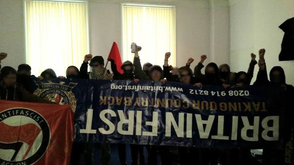 Antifascists with the seized BF banner.